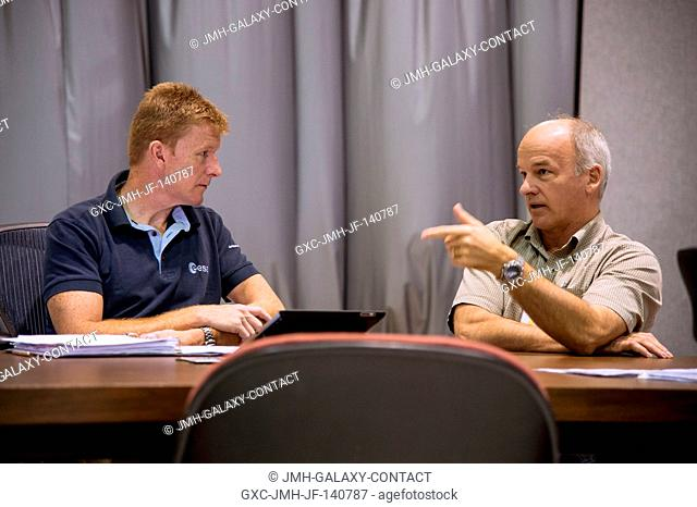 European Space Agency astronaut Timothy Peake (left), Expedition 4647 flight engineer; and NASA astronaut Jeff Williams, Expedition 47 flight engineer and...