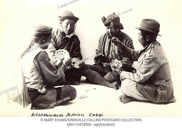 Four Bhutani Rickshaw Drivers playing cards