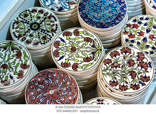 Collection of Traditional Turkish ceramic trivets on sale at Grand Bazaar in Istanbul, Turkey. Colorful ceramic souvenirs