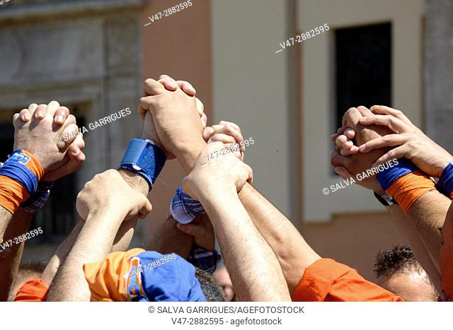 Group of people holding hands to hold the castle (Castell), Valencia, Spain