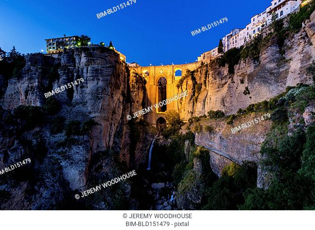 Bridge and buildings on sheer cliffs, Ronda, Andalusia, Spain
