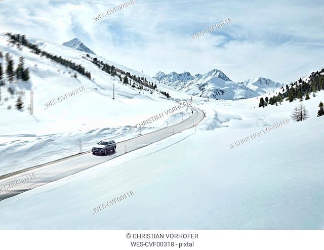 Austria, Tyrol, Sellrain Valley, Kuehtai, Car on mountain road in winter
