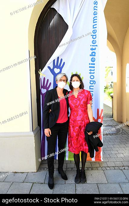 09 May 2021, Bavaria, Munich: The couple Christine Walter (l) and Almut Münster show themselves before a Catholic service with blessing of homosexual couples as...