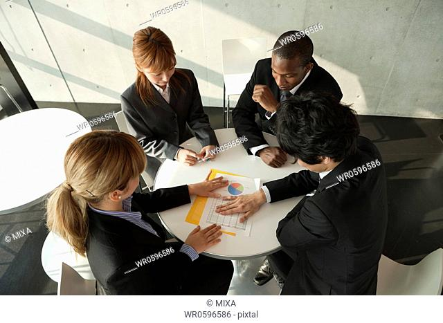 Businessmen and businesswomen having a meeting