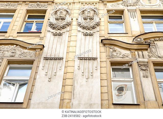 An elegant and ornate Art Nouveau facade on a building in Prague, Czech Republic, Europe