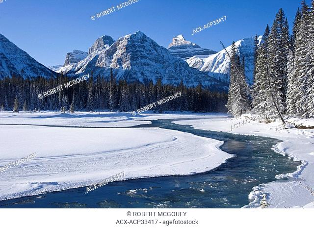 View of the freezing Athabasca River traveling through the Rocky Mountains of Jasper National Park, Alberta, Canada