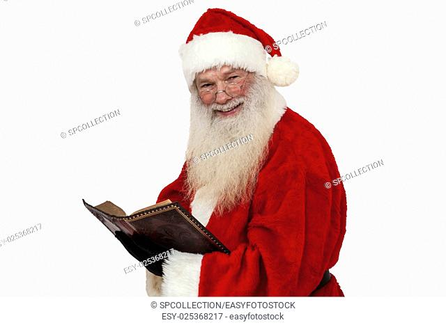 Santa Claus reading and smiling (isolated)