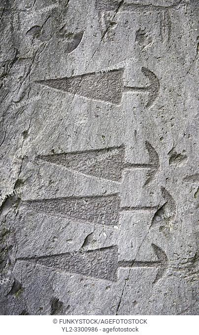 Prehistoric petroglyphs, rock carvings, in an ancient snctuary carved by the the ancient Camuni people in the Copper Age around the 3rd milleneum BC