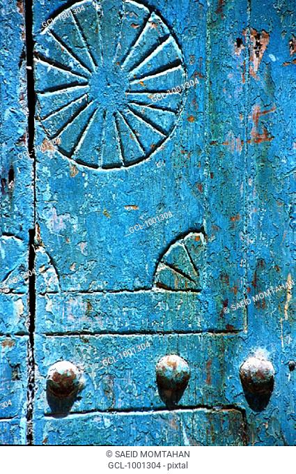 Ornaments on a blue wooden door