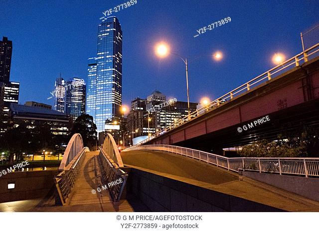 pedestrian bridge and Kings Bridge, with Melbourne city skyline