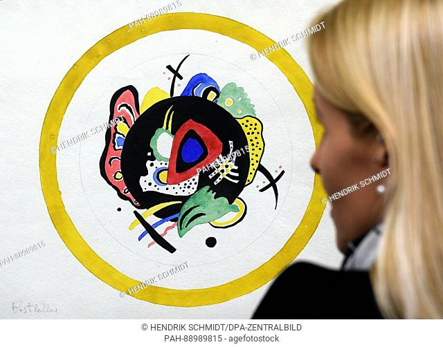 A woman looks at a fruit plate by Wassily Kandinsky (1920/21) during a preview at the art museum Moritzburg in Halle/Saale, Germany, 8 March 2017
