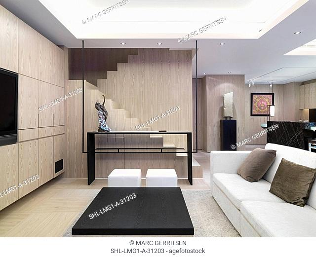 Simple modern living room with staircase