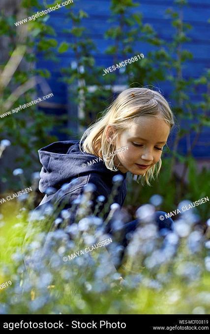 Portrait of a girl in allotment garden