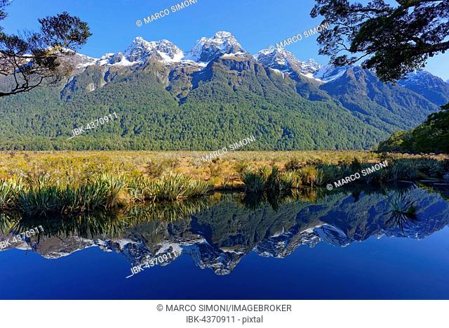Lake Matheson with reflections of mountains, Fiordland National Park, Milford Sound, South Island, Southland, New Zealand