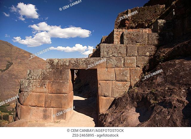 A stone door at the Inca terraces showing the entrance of the ancient Inca settlement, Pisac Ruins , Cusco Region, Peru, South America