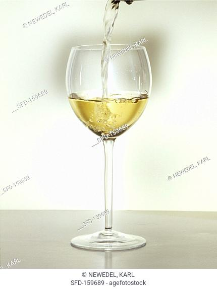 Pouring a glass of white wine (2)