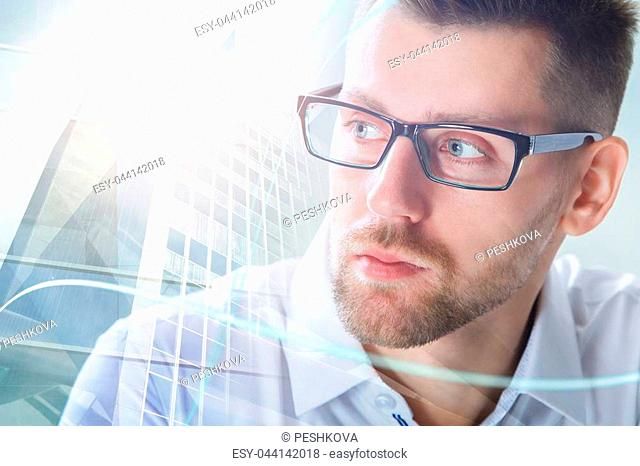 Portrait of attractive young businessman on abstract city background with daylight. Double exposure