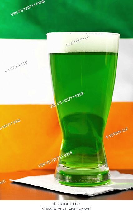 Green beer against Irish flag