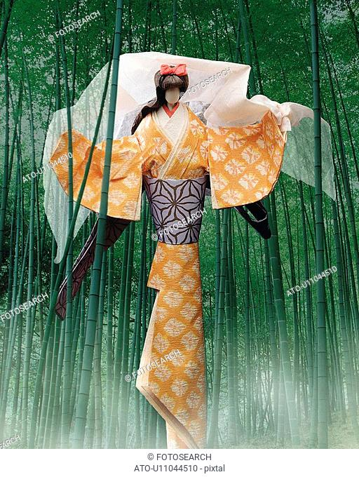 Bamboo grove and Japanese female doll holding a veil, front view, composition