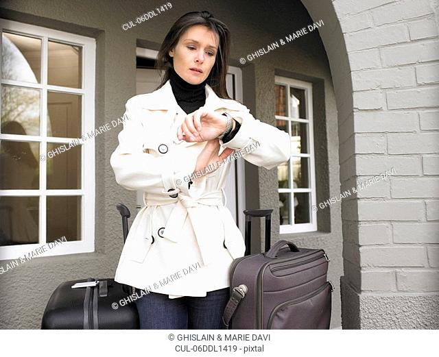 Woman with suitcases, waiting
