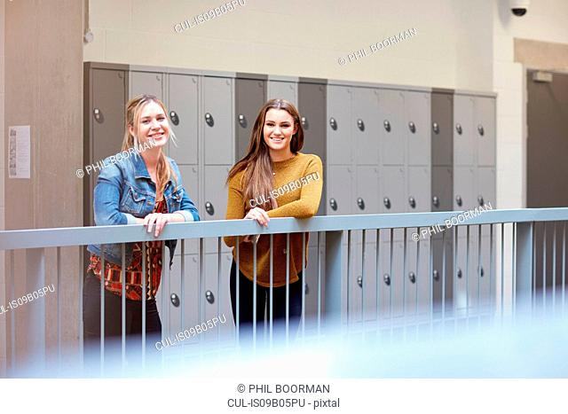 Portrait of two female students in higher education college locker room