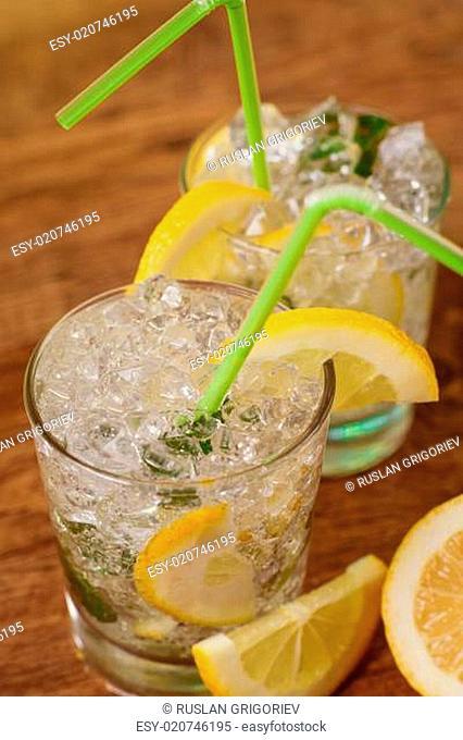 Lemonade with fresh lemon and mint by lemon reamer