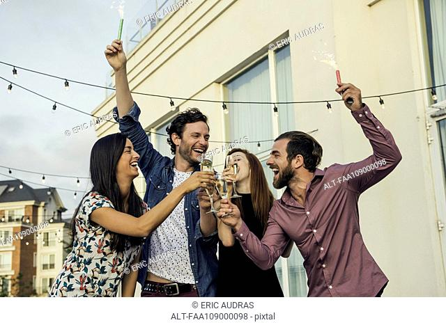 Friends celebrating with champagne outdoors