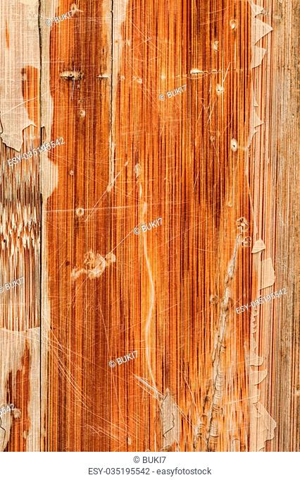 Photograph of obsolete old, weathered, varnished Wooden Laminated Panel, cracked, scratched, grunge texture