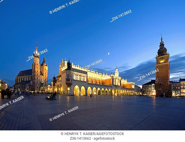 The Cloth Hall, St Mary the Virgin Basilica and Town Hall at Main Market Square at dusk, Krakow, Poland, Europe