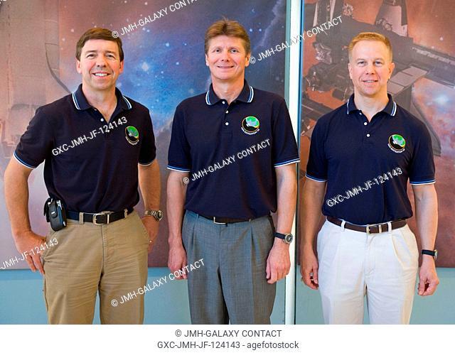 Cosmonaut Gennady Padalka (center), Expedition 19 commander; along with astronauts Michael Barratt (left) and Tim Kopra, both flight engineers