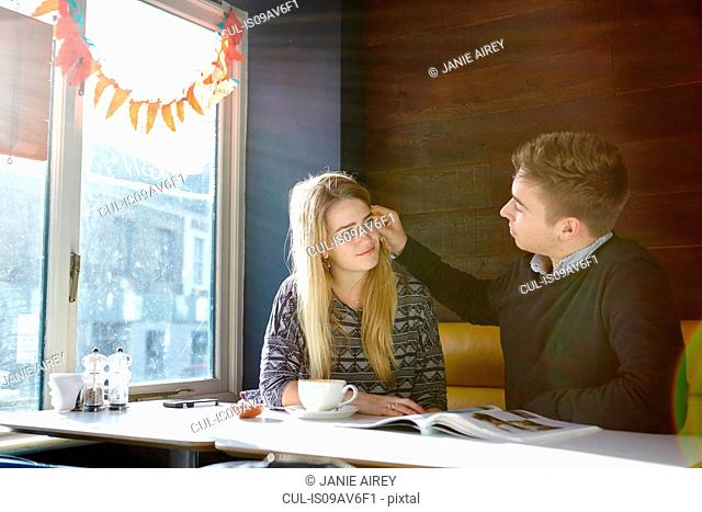 Romantic young couple on date in cafe
