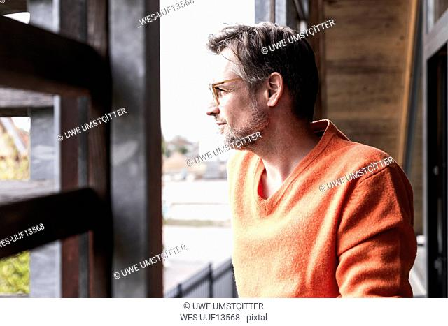 Man at home looking at distance