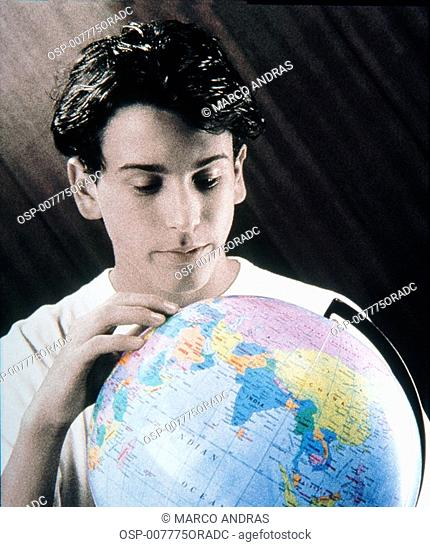 young teenager studing with earth globe