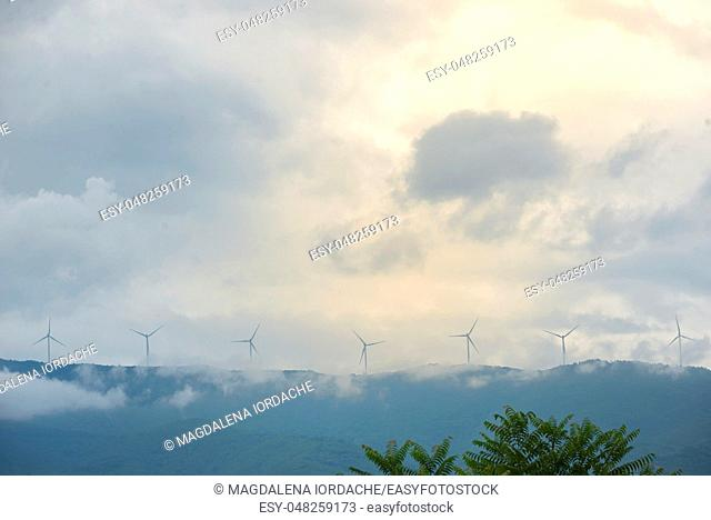 Windmills on Greek hills and clouds