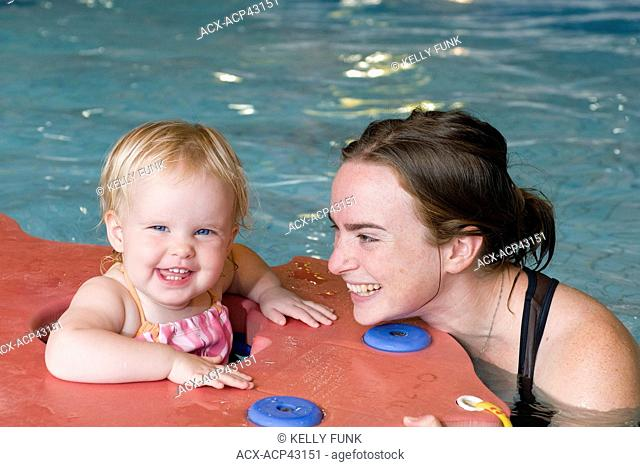 A mother and child enjoy a swim at a pool in Sechelt, British Columbia, Sunshine coast, Vancouver coast and moutain region, Canada