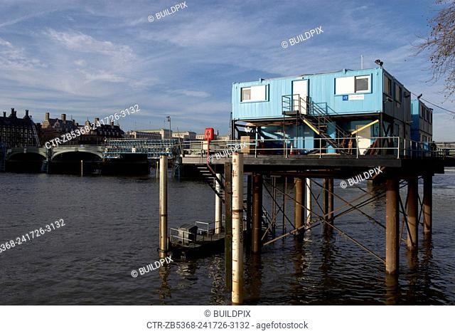 Prefab portacabin on stilts, river Thames, London, UK
