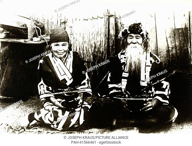 Ainu couple on the island of Hokkaido. Pictured in the early 1920th. - /Japan