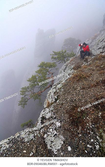 photographer taking picture in southern demergi mountain area of crimea