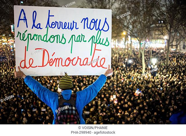 People take part in a vigil in Place de la Republique, Paris, France, Wednesday January 7, 2015, after a deadly terror attack on French satirical magazine...