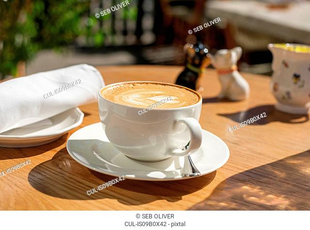 Cup of coffee on table, New York, USA