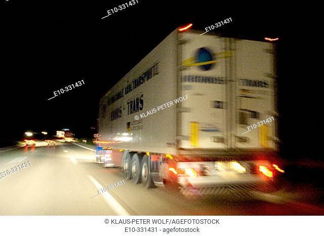 Night traffic on the Autobahn A8 alzburg München at the Brunntaldreieck near Munich. Germany