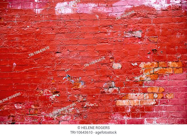 Painted Brick Wall With Paint Peeling Off