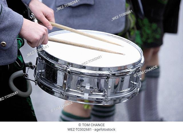 Germany, Bavaria, Drummer performing drum roll