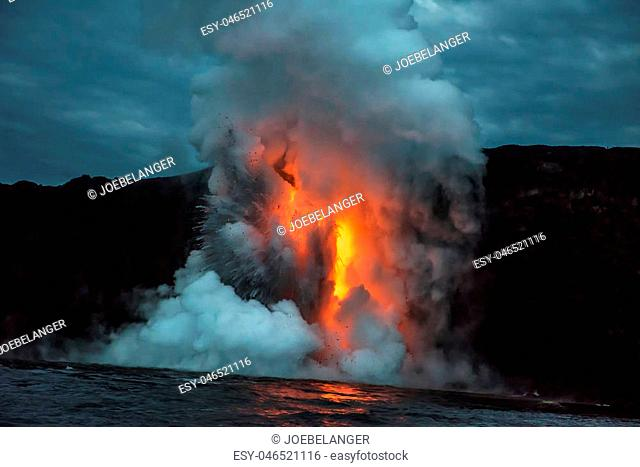A lava flow on the big Island of Hawaii known as the fire hose spews out molten magma from Kilauea Volcano into the ocean