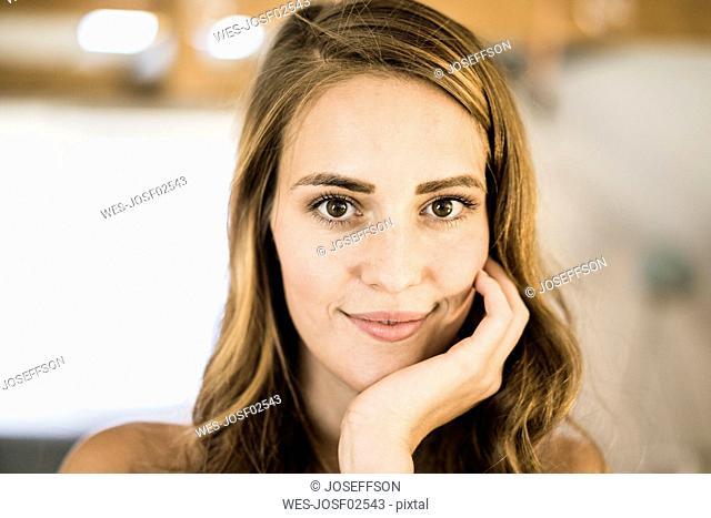 Portrait of smiling brunette woman