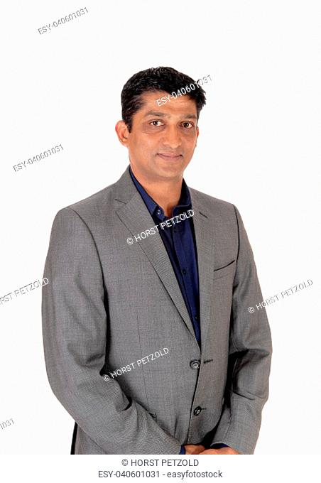A waist up image of a handsome business man in a gray suit and blue.shirt standing isolated for white background