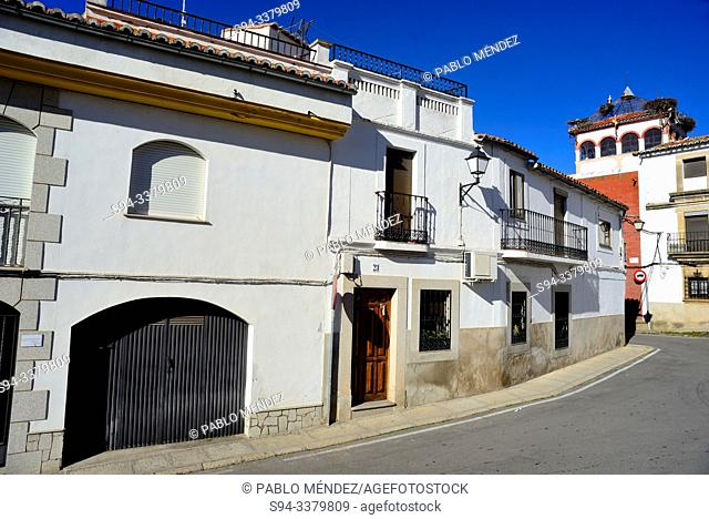 Street and square of the church in Malpartida de Caceres, Caceres, Spain