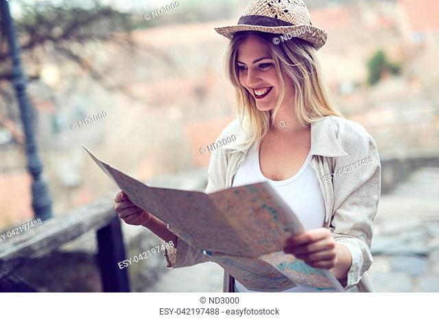 Happy beautiful female tourist sightseeing and exploring