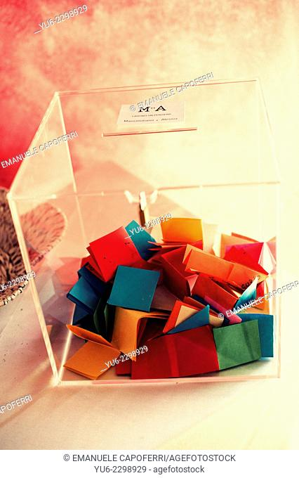 Plexiglass box with tickets colored inside