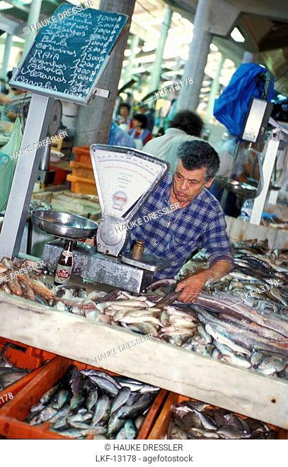 Vendor at a fish stand at the market hall, LoulÚ, Faro, Algarve, Portugal, Europe